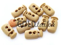 Fixator for cord d = 4mm plastic two-hole 12mm * 23mm beige, 10 pcs